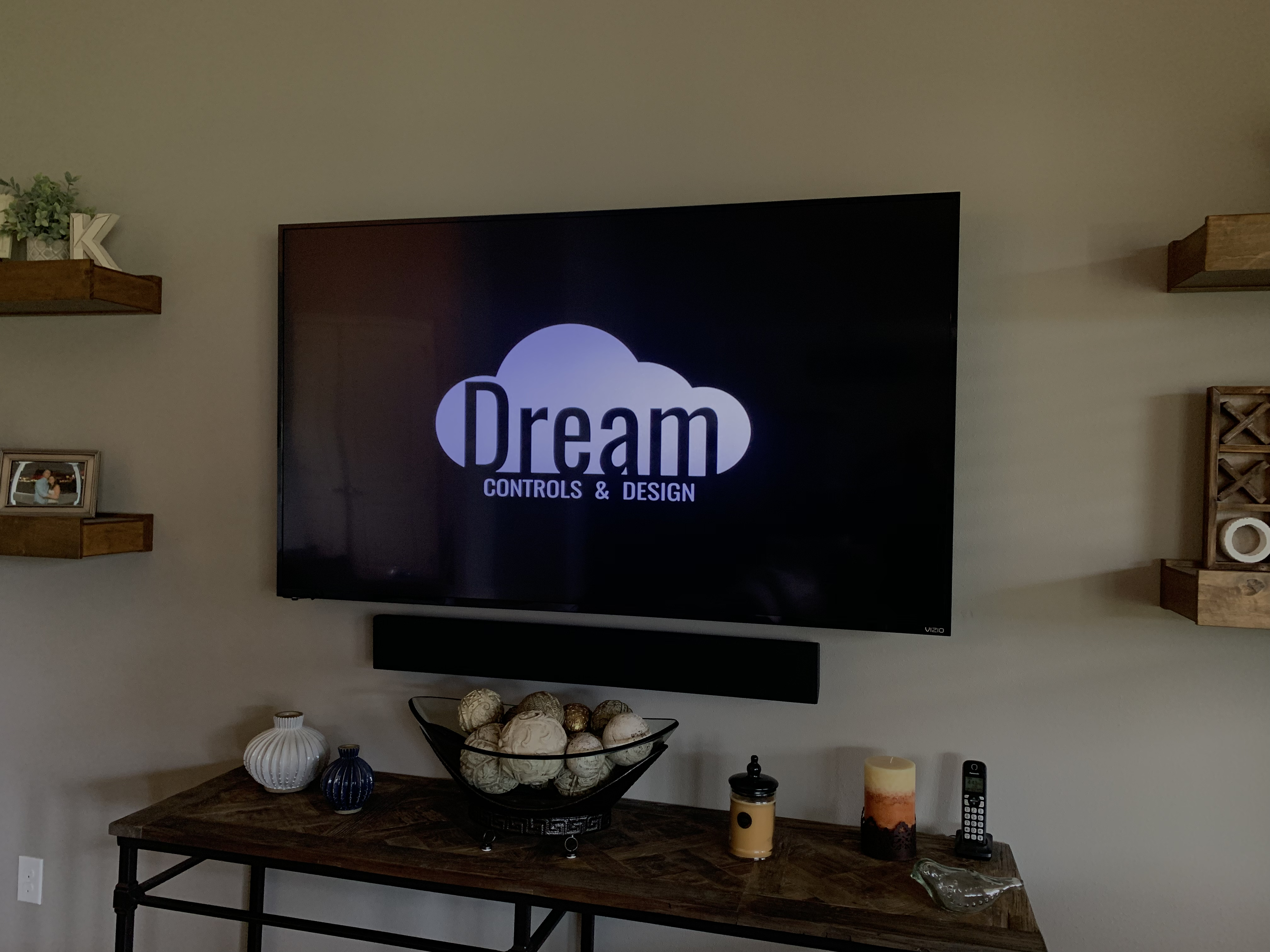 Photo of wall mounted TV by Dream Controls & Design