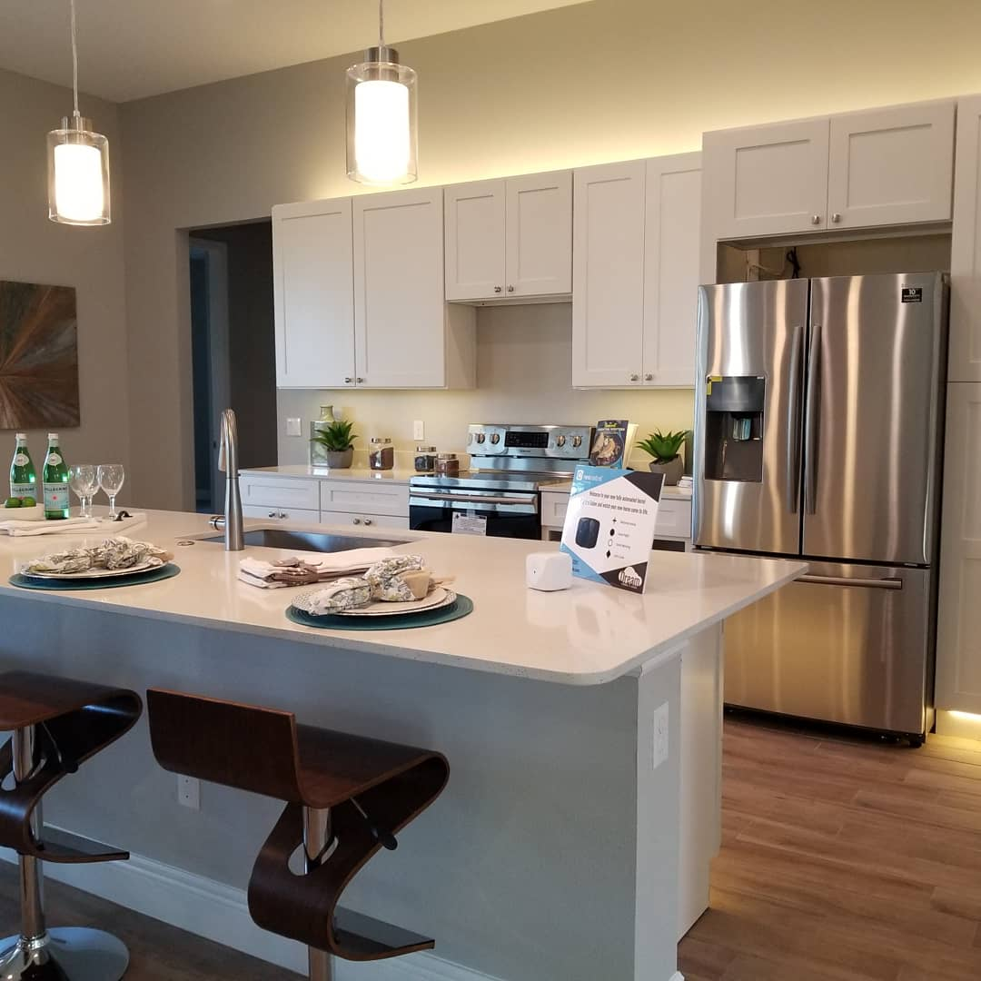 Photo of kitchen in New Construction home in East Orlando with Neocontrol automation and cabinet lighting by Dream Controls and Design